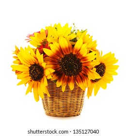Bouquet from sunflowers in basket isolated on white