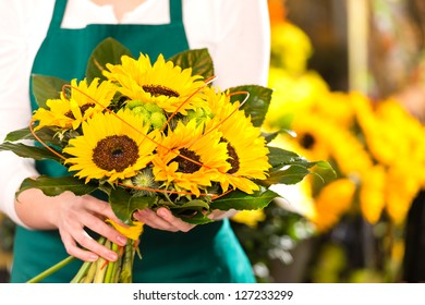 Bouquet sunflowers flower shop female florist holding