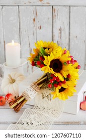 Bouquet of sunflowers and hypericum berries, candles, lace. Postcard motif.