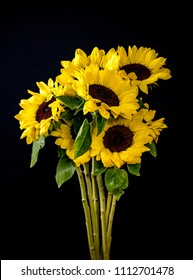 Bouquet of sunflowers on black background