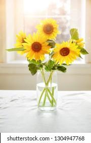 Bouquet sunflowers on sunny window Summery still life windowsill table.
