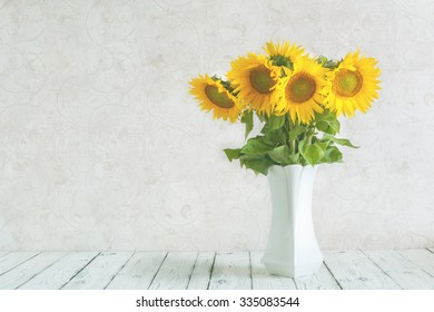 bouquet of sunflowers in a vase . gift. a stylish minimalist design . space for inscriptions .