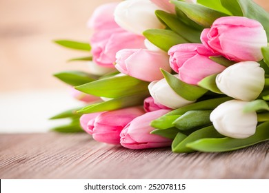 bouquet of tulips in front of spring scene