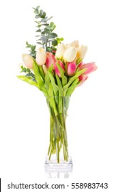 bouquet of tulips in a glass vase on a white background