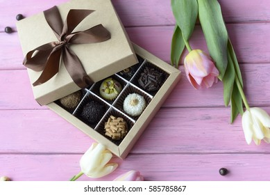 bouquet of tulips and handmade chocolates to Women's Day