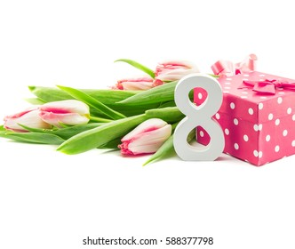Bouquet of tulips isolated on white background with a red doted gift box as a symbol of the holiday. Spring flowers. Greeting card for 8 March Woman's Day.