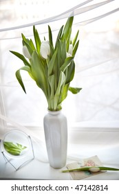 Bouquet of tulips with a mirror
