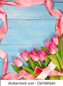 Bouquet of tulips on blue wooden table. Happy women's day. 8 March., Mother's Day. Flat lay and copy space