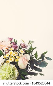 Bouquet with various flowers in pastel colors, toned