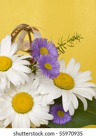 bouquet with white camomiles on a yellow background