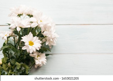 bouquet of white chrysanthemums, top view, copy space