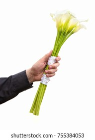Bouquet of white flowers isolated on the white background with no shadow. A hand holding a bunch of white lily, wedding gratulation.