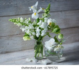 A bouquet of white flowers on white boards