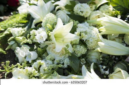 bouquet with white funeral flowers as lily