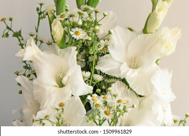 Bouquet of white gladioli. Whiteness delicate gladiolus flowers. Close-up, white background