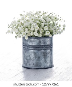Bouquet of white gypsophila, baby's breath flowers, on wooden background