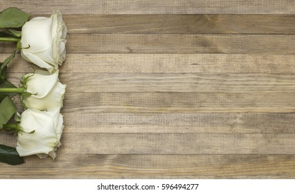 bouquet white pose flowers on brown wooden background