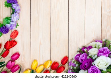 Bouquet white and purple roses. Pink, red, yelow, tulips on wooden background. Top view.