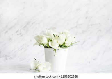 A bouquet of white roses on a marble background