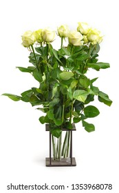 bouquet of white roses in the original wooden vase. Isolated on white background.