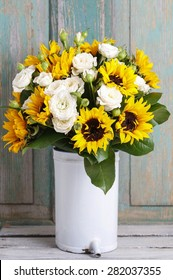 Bouquet of white roses and sunflowers