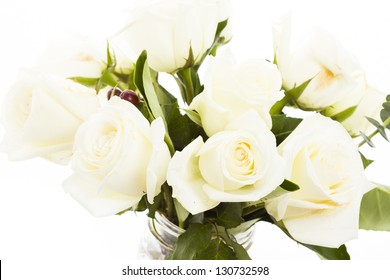 Bouquet of white roses in vase with red heart.