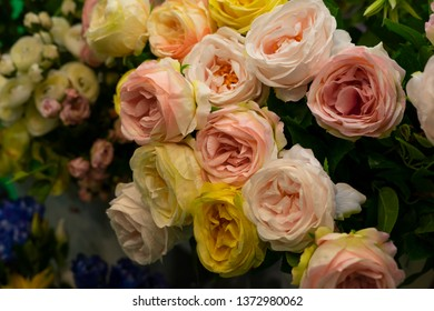 Bouquet of white, yellow and pink roses.