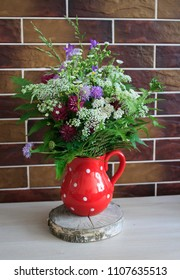 A bouquet of wild flowers. A bouquet of flowers in the interior of the house. Wildflowers background.