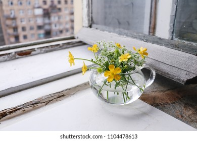bouquet of wild flowers at an old window