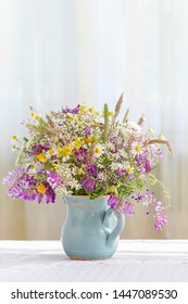 Bouquet of wild flowers on the table.