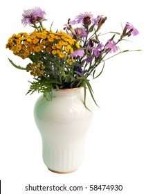 Bouquet of wild flowers in a white porcelain vase, isolated on the white. July, the Central Russia