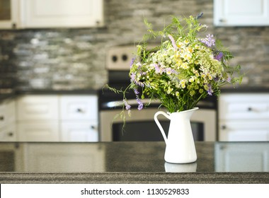 Bouquet of wildflowers in vase on kitchen table