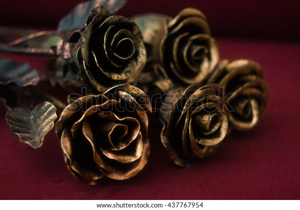 bouquet-wrought-iron-copper-gold-600w-437767954.jpg