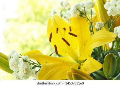 A bouquet of yellow lilies and white gypsophilia. Prostrnost for copying.