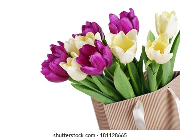 bouquet from yellow and purple tulips in a paper package