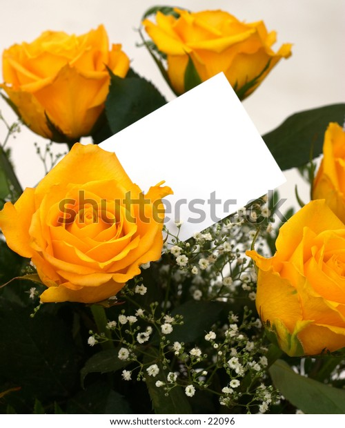 A bouquet of yellow roses with a blank gift tag.
