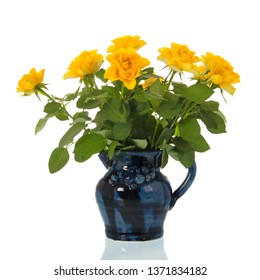 Bouquet yellow roses in blue vase isolated over white background