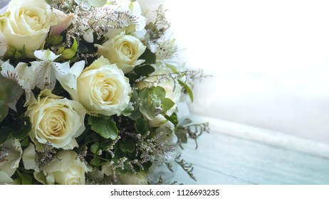 Bouquet of yellow roses and orchid , floral background