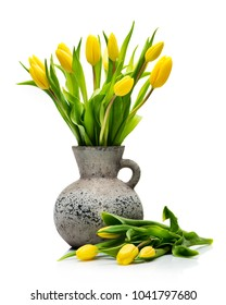 Bouquet yellow tulips in a vase on a white background