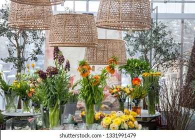 Bouquets of different flowers for sale in a graden center during spring time.