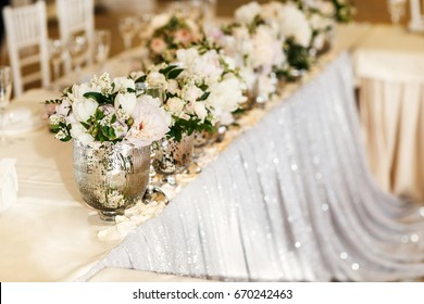 Bouquets flower in vase on the wedding table.