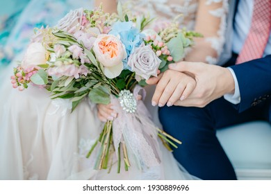 bouquets of roses in bride's hands
