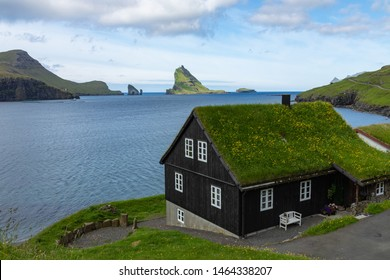 Bour village. Typical grass-roof houses and green mountains. Vagar island, Faroe Islands. Denmark. Europe.