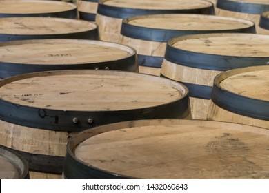 Bourbon Barrel Tops in a Row in Storage Area