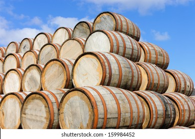 Bourbon barrels stacked at a distillery in Scotland