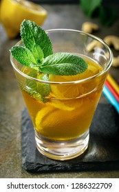 Bourbon based cocktail with lemon and mint, closeup