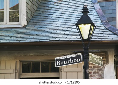 Bourbon Street sign with the haunted Lafitte's Blacksmith Shop in the background, New Orleans, Louisiana