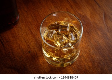 Bourbon whiskey on whiskey glass with rustic and dark theme