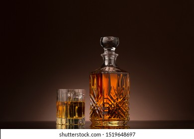Bourbon whiskey served on the rocks in crystal glassware.