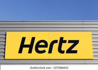 Bourg, France - April 5, 2019: Hertz logo on a wall. Hertz is an American car rental company with international locations in 145 countries worldwide